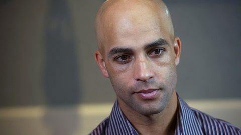 <p>               FILE - This is a Sept. 12, 2015, file photo showing former tennis star James Blake discussing his mistaken arrest by the New York City Police Department during an interview in New York. Nearly five years later, Blake says he never suspected the large man running toward him was a plainclothes New York City policeman. But Blake, who is black, had been mistakenly identified as a suspect in a credit card fraud scheme. Video captured the undercover officer grabbing him by the arm, throwing him to the sidewalk face down and handcuffing him.  All of which intensified Blake's reaction to video of George Floyd's death shortly after being detained by Minneapolis police last week. (AP Photo/Bryan R. Smith, File)             </p>