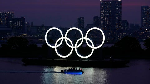 <p>               FILE - In this June 3, 2020, photo, the Olympic rings float in the water at sunset in the Odaiba section in Tokyo. The Japanese public is being prepared for the reality of next year's postponed Olympics where athletes are likely to face quarantines, spectators will be fewer, and the delay will cost taxpayers billions of dollars. In the last several weeks, IOC President Thomas Bach has given selected interviews outside Japan and hinted at empty stadiums, quarantines and virus testing. (AP Photo/Eugene Hoshiko, File)             </p>