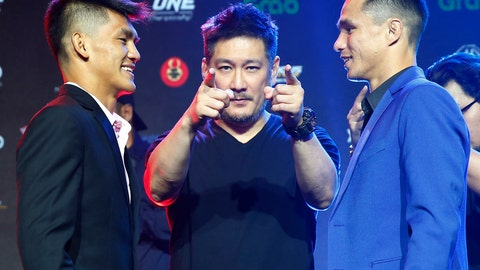 <p>               FILE - In this Tuesday, July 30, 2019 file photo, Chatri Sityodtong, Chair and CEO of ONE Championship, center, gestures as Reece McLaren, right, of Australia and Danny Kingad, left, of the Philippines face off during the media presentation for this Friday's ONE Championship mixed martial arts fight dubbed: Dawn of Heroes, in suburban Pasay city south of Manila, Philippines. One Championship definitely will return to action this summer during this unprecedented public health crisis, Chatri Sityodtong told The Associated Press on Wednesday June 10, 2020, but the promotion has not finalized a date or location for its first fights. (AP Photo/Bullit Marquez, File)             </p>
