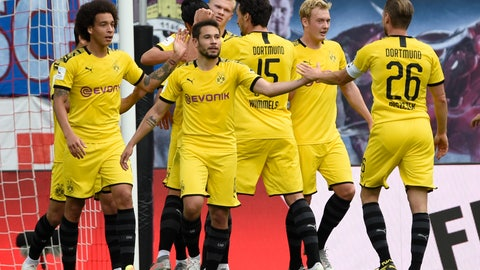<p>               Dortmund's Erling Braut Haaland, center background, celebrates with his teammates after he scored his side's first goal during the German Bundesliga soccer match between RB Leipzig and Borussia Dortmund in Leipzig, Germany, Saturday, June 20, 2020. (AP Photo/Jens Meyer, Pool)             </p>