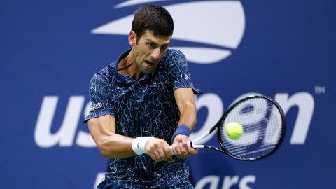 """<p>               FILE - In this Sept. 9, 2018, file photo, Novak Djokovic, of Serbia, returns a shot to Juan Martin del Potro, of Argentina, during the men's final of the U.S. Open tennis tournament in New York. Djokovic is fretting about """"harsh"""" restrictions on players' entourages and other """"extreme"""" changes proposed for the U.S. Open, if it is played starting in August. (AP Photo/Adam Hunger, File)             </p>"""
