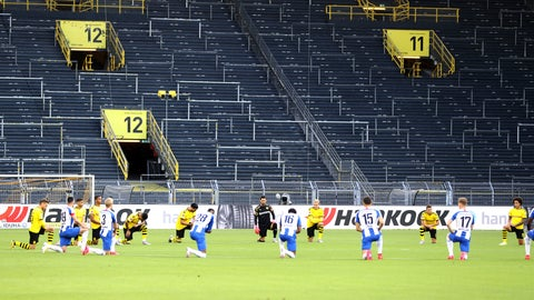 <p>               Players of both teams (Dortmund yellow jersey) kneel around the centre circle as a mark of support for the protests after the recent killing of black American George Floyd by police officers in Minneapolis, USA, before the German Bundesliga soccer match between Borussia Dortmund and Hertha BSC Berlin in Dortmund , Germany, Saturday, June 6, 2020. (Lars Baron, Pool via AP)             </p>