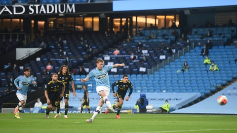 <p>               Manchester City's Kevin De Bruyne scores from the penalty spot for his team's second goal during the English Premier League soccer match between Manchester City and Arsenal at the Etihad Stadium in Manchester, England, Wednesday, June 17, 2020. The English Premier League resumes Wednesday after its three-month suspension because of the coronavirus outbreak. (Peter Powell/Pool via AP)             </p>