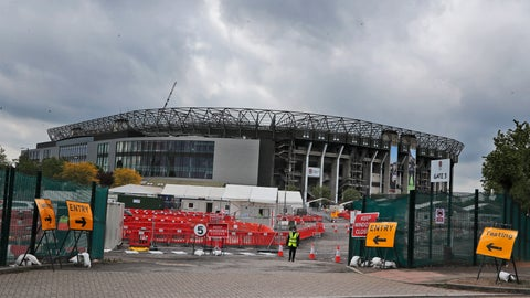 <p>               Staff await the arrival of people at a the COVID-19 testing facility at Twickenham Rugby stadium in London, Wednesday, April 29, 2020. Coronavirus testing is now available for more people in England from today as the government relaxed rules on eligibility. (AP Photo/Frank Augstein)             </p>