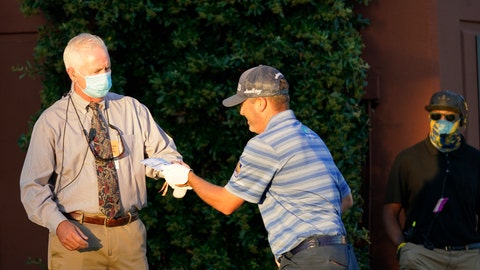 <p>               A rules official hands a score card to Ryan Palmer at the first tee during the first round of the Charles Schwab Challenge golf tournament at the Colonial Country Club in Fort Worth, Texas, Thursday, June 11, 2020. (AP Photo/David J. Phillip)             </p>