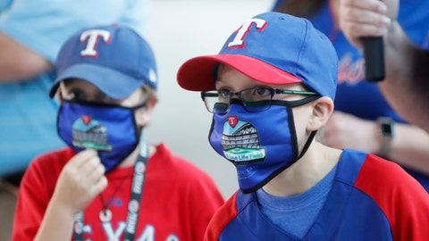 <p>               FILE - In this June 1, 2020, file photo, Gavin Bollmer, left, and his buddy, Austin LaFountain, wear Globe Life Field masks as they tour the home of the Texas Rangers baseball team in Arlington, Texas. Many organizations are trying to bridge the budget gap from the coronovirus through enhanced sponsorship sales, such as temporary billboards that could be stretched over unsold sections of seats. Teams and leagues are selling branded face masks and other personal protective equipment. Almost all of them are trying to engage fans in new and creative ways. It won't come close to making up the budget shortfall, but the hope is to survive long enough for sports to return to normal. (AP Photo/LM Otero, File)             </p>