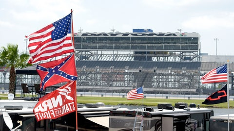 <p>               FILE - In this July 4, 2015, file photo, confederate and American flags fly on top of motor homes at Daytona International Speedway in Daytona Beach, Fla. Bubba Wallace, the only African-American driver in the top tier of NASCAR, calls for a ban on the Confederate flag in the sport that is deeply rooted in the South. (AP Photo/Phelan M. Ebenhack, File)             </p>