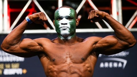 <p>               FILE - In this Dec. 13, 2019, file photo, Kamaru Usman poses during the ceremonial weigh-in event ahead of his fight against Colby Covington in UFC 245 at T-Mobile Arena in Las Vegas. The UFC revealed the location Tuesday, June 9, 2020, and announced a series of fan-free shows for Fight Island, in Abu Dhabi, starting with a card tentatively featuring three title fights at UFC 251 on July 11. The pay-per-view UFC 251 show is expected to be headlined by U.S. welterweight Kamaru Usman's title defense against Brazil's Gilbert Burns. (Chase Stevens/Las Vegas Review-Journal via AP, File)             </p>