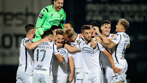 <p>               Famalicao's Pedro Goncalves, center left, celebrates after scoring his side's second goal during the Portuguese League soccer match between FC Famalicao and FC Porto in Famalicao, Portugal, Wednesday, June 3, 2020. The Portuguese League soccer matches resumed Wednesday without spectators because of the coronavirus pandemic. (Jose Coelho/Pool via AP)             </p>