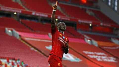 <p>               Liverpool's Sadio Mane celebrates scoring his side's fourth goal during the English Premier League soccer match between Liverpool and Crystal Palace at Anfield Stadium in Liverpool, England, Wednesday, June 24, 2020. (Phil Noble/Pool via AP)             </p>