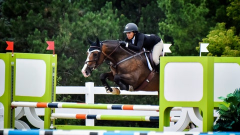 <p>               In this undated photo provided by Karie Alderman, Lauryn Gray competes during the Trillium Championships at Caledon Equestrian Park in Palgrave, Canada. One of the most candid conversations about race in sports is coming from a most unlikely of places: the show-jumping world. Gray, who has one black and one white parent, wrote a blog after she was inspired by fellow equestrian Sophie Gochman. (Karie Alderman via AP)             </p>