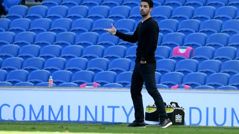 <p>               Arsenal's head coach Mikel Arteta gestures during the English Premier League soccer match between Brighton & Hove Albion and Arsenal at the AMEX Stadium in Brighton, England, Saturday, June 20, 2020. (Mike Hewitt/Pool via AP)             </p>