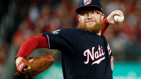 <p>               FILE - In this Oct. 27, 2019, file photo, Washington Nationals relief pitcher Sean Doolittle throws during the seventh inning of Game 5 of the baseball World Series against the Houston Astros, in Washington. The Nationals told their minor leaguers on Monday, June 1, 2020, they will receive their full weekly stipends of $400 at least through June after Washington reliever Sean Doolittle tweeted that the team's major league players would cover a planned cut in those payments.(AP Photo/Jeff Roberson, File)             </p>