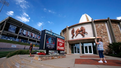<p>               FILE - In this Aug. 7, 2015, file photo, a visitor to the Pro Football Hall of Fame pauses to take a photo of the sign in front in Canton, Ohio. The NFL has canceled the Hall of Fame game that traditionally opens the preseason and is delaying the 2020 induction ceremonies because of the coronavirus pandemic, two people with direct knowledge of the decision told The Associated Press on Thursday, June 25, 2020. The people spoke to the AP on condition of anonymity because the decision has not been publicly announced, though an announcement is expected later Thursday. (AP Photo/Gene J. Puskar, File)             </p>