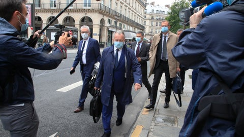 <p>               Lyon soccer club President Jean-Michel Aulas, center, wears a mask as he arrives with his legal team for a hearing at France's highest administrative court, the Council of State, in Paris, Thursday, June 4, 2020. Jean-Michel Aulas is asking French authorities to backpedal on their decision to end the football season prematurely amid the coronavirus pandemic. The men's league was canceled with 10 rounds remaining, Paris Saint-Germain declared champion, and Lyon finished outside the European places in seventh. (AP Photo/Michel Euler)             </p>
