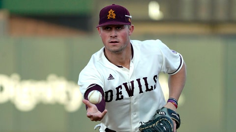 <p>               In this Feb. 18, 2020 photo Arizona State infielder Spencer Torkelson makes a play during an NCAA college baseball game in Phoenix, Ariz. The Detroit Tigers agreed to terms Tuesday, June 30, 2020 with No. 1 overall draft pick Spencer Torkelson, and the team said he's joining the player pool for this abbreviated season. (AP Photo/Rick Scuteri)             </p>