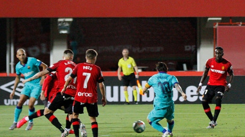 <p>               Barcelona's Lionel Messi, second right, kicks the ball to score his side's fourth goal during the Spanish La Liga soccer match between Mallorca and FC Barcelona at Son Moix Stadium in Palma de Mallorca, Spain, Saturday, June 13, 2020. With virtual crowds, daily matches and lots of testing for the coronavirus, soccer is coming back to Spain. The Spanish league resumes this week more than three months after it was suspended because of the COVID-19 pandemic. (AP Photo/Francisco Ubilla)             </p>