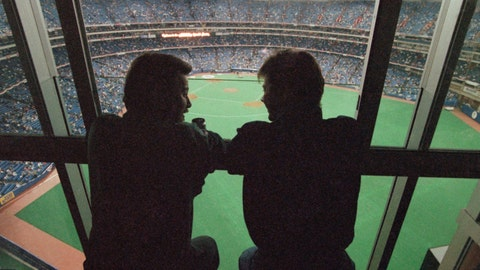 <p>               FILE - In this Oct. 22, 1992, file photo, spectators look out at the field of the SkyDome in Toronto, from a window of the SkyDome Hotel before Game 5 of the World Series between the Toronto Blue Jays and the Atlanta Braves. This week, Major League Baseball players and owners reached an agreement to play an abbreviated, 60-game season that would start July 23 or 24 in teams' home ballparks. But the seats will be empty. Instead, fans hoping to see a game in person will be have to settle for pressing their faces up against hotel windows, squinting through metal grates or climb to rooftops when baseball returns this month in otherwise empty stadiums. (AP Photo/Rusty Kennedy, File)             </p>