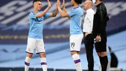 <p>               Manchester City's Phil Foden, left, gestures with teammate Leroy Sane as he is substituted during the English Premier League soccer match between Manchester City and Burnley at Etihad Stadium, in Manchester, England, Monday, June 22, 2020. (AP Photo/Michael Regan,Pool)             </p>
