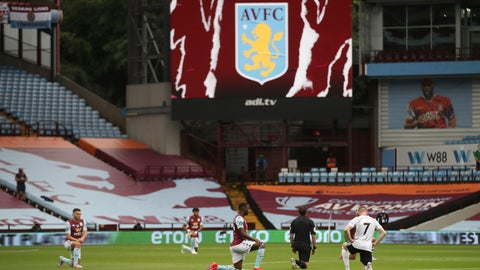 <p>               Players kneel prior to the start of the English Premier League soccer match between Aston Villa and Sheffield United at Villa Park in Birmingham, England, Wednesday, June 17, 2020. The English Premier League resumes Wednesday after its three-month suspension because of the coronavirus outbreak. (Carl Recine/Pool via AP)             </p>