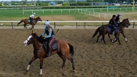 <p>               Riders and horses participate in work outs at Belmont Park in Elmont, N.Y., Friday, June 19, 2020. The Belmont Stakes is scheduled to run on Saturday. (AP Photo/Seth Wenig)             </p>