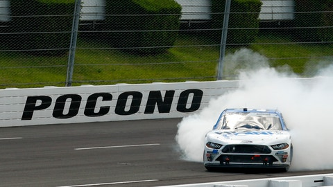 <p>               Chase Briscoe smokes his tires in celebration after winning a NASCAR Xfinity Series auto race at Pocono Raceway, Sunday, June 28, 2020, in Long Pond, Pa. (AP Photo/Matt Slocum)             </p>