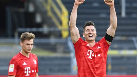 <p>               Munich's Joshua Kimmich, left, looks on as his teammate Robert Lewandowski, right, celebrates after the German Bundesliga soccer match between Borussia Dortmund and FC Bayern Munich in Dortmund, Germany, Tuesday, May 26, 2020. The German Bundesliga is the world's first major soccer league to resume after a two-month suspension because of the coronavirus pandemic. (Federico Gambarini/DPA via AP, Pool)             </p>