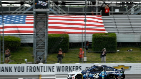 <p>               Kevin Harvick takes the checkered flag as he crosses the finish line to win a NASCAR Cup Series auto race at Pocono Raceway, Saturday, June 27, 2020, in Long Pond, Pa. (AP Photo/Matt Slocum)             </p>