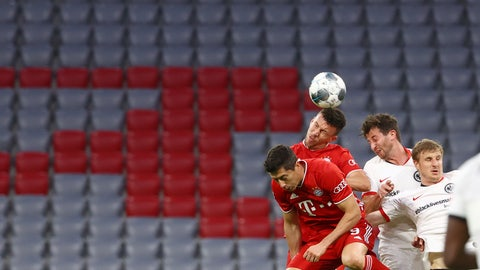 <p>               Bayern Munich's Ivan Perisic heads the ball infront of empty stands during the German soccer cup semi-final match between Bayern Munich and Eintracht Frankfurt in Munich, Germany, Wednesday, June 10, 2020. (Kai Pfaffenbach/Pool via AP)             </p>