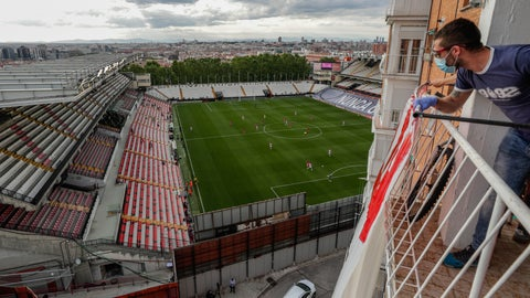 <p>               A soccer supporter watches from a balcony the second-division game match between Rayo Vallecano and Albacete in Madrid, Spain, Wednesday, June 10, 2020. With virtual crowds, daily matches and lots of testing for the coronavirus, soccer is coming back to Spain. The Spanish league resumes this week more than three months after it was suspended because of the pandemic, becoming the second top league to restart in Europe. The Bundesliga was first. The Premier League and the Italian league should be next in the coming weeks. (AP Photo/Manu Fernandez)             </p>