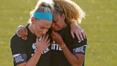 <p>               Chicago Red Stars' Julie Ertz, left, holds Casey Short after players for their team knelt during the national anthem before an NWSL Challenge Cup soccer match against the Washington Spirit at Zions Bank Stadium, Saturday, June 27, 2020, in Herriman, Utah. (AP Photo/Rick Bowmer)             </p>