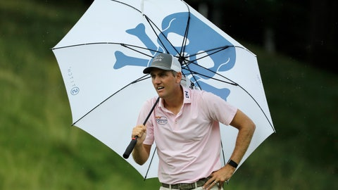 <p>               Brendon Todd looks at a competitors tee shot while sheltering from the rain with an umbrella on the 18th hole during the third round of the Travelers Championship golf tournament at TPC River Highlands, Saturday, June 27, 2020, in Cromwell, Conn. (AP Photo/Frank Franklin II)             </p>