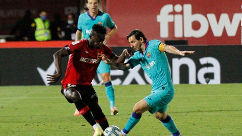 <p>               Barcelona's Lionel Messi, right, vies for the ball with Marllorca's Iddrisu Mohamed Baba during the Spanish La Liga soccer match between Mallorca and FC Barcelona at Son Moix Stadium in Palma de Mallorca, Spain, Saturday, June 13, 2020. With virtual crowds, daily matches and lots of testing for the coronavirus, soccer is coming back to Spain. The Spanish league resumes this week more than three months after it was suspended because of the COVID-19 pandemic. (AP Photo/Francisco Ubilla)             </p>