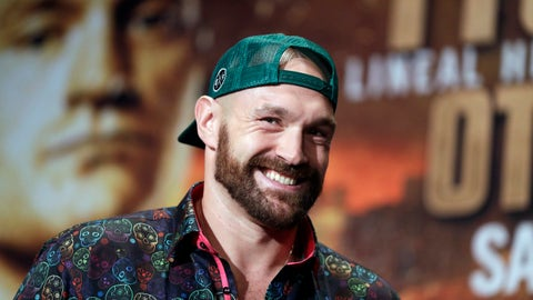 <p>               FILE - In this Sept. 11, 2019, file photo, Tyson Fury smiles during a news conference in Las Vegas. An all-British world heavyweight title showdown between Anthony Joshua and Tyson Fury in 2021 is a step closer. Fury said Wednesday, June 10, 2020, that an agreement has been reached with Joshua's camp on a two-fight deal between the current holders of the heavyweight belts. (AP Photo/Isaac Brekken, File)             </p>