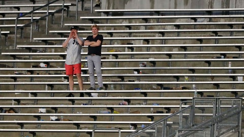 <p>               FILE - In this Aug. 2, 2017, file photo, baseball fans cheer from the right field bleacher seats after a rain delay in a baseball game between the New York Yankees and the Detroit Tigers in New York. The crippling grip the coronavirus pandemic has had on the sports world has forced universities, leagues and franchises to evaluate how they might someday welcome back fans. (AP Photo/Julie Jacobson, File)             </p>