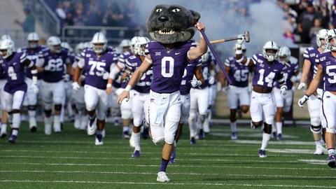 Nov 16, 2019; Manhattan, KS, USA; Kansas State Wildcats mascot Willie Wildcat leads the football team onto the field before the start of a game against the West Virginia Mountaineers at Bill Snyder Family Stadium. Mandatory Credit: Scott Sewell-USA TODAY Sports