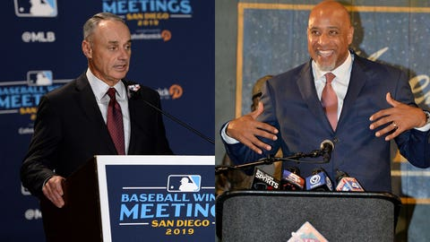 Dec 10, 2019; San Diego, CA, USA; MLB commissioner Rob Manfred speaks to the media before announcing the All-MLB team during the MLB Winter Meetings at Manchester Grand Hyatt. Mandatory Credit: Orlando Ramirez-USA TODAY Sport  Jun 21, 2017; Kansas City, MO, USA; Major League Baseball Player Association executive director Tony Clark speaks during a presentation at the Negro Leagues Baseball Museum. Mandatory Credit: Denny Medley-USA TODAY Sports