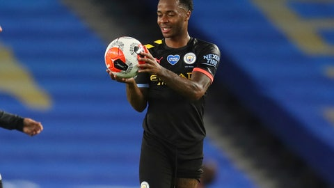 <p>               Manchester City's Raheem Sterling holds the ball at the end of the English Premier League soccer match between Brighton and Manchester City at the Falmer stadium in Brighton, England, Saturday, July 11, 2020. (Cath Ivill/Pool via AP)             </p>