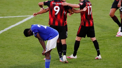<p>               Bournemouth's Junior Stanislas, top centre, celebrates with teammates after their third goal during the English Premier League soccer match between Bournemouth and Leicester City at Vitality Stadium in Bournemouth, England, Sunday, July 12, 2020. (AP Photo/Andy Couldridge,Pool)             </p>