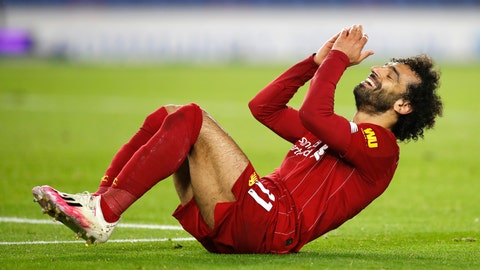 <p>               Liverpool's Mohamed Salah reacts after missing a shot at goal during the English Premier League soccer match between Brighton and Liverpool at Falmer Stadium in Brighton, England, Wednesday, July 8, 2020. (AP Photo/Paul Childs,Pool)             </p>