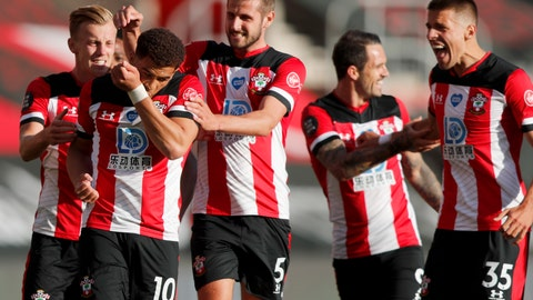 <p>               Southampton's Che Adams, second left, is congratulated by teammates after scoring his team's first goal during the English Premier League soccer match between Southampton and Manchester City at St. Mary's Stadium in Southampton, England, Sunday, July 5, 2020. (AP Photo/Frank Augstein,Pool)             </p>