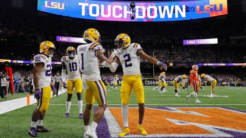 <p>               FILE - In this Jan. 13, 2020, file photo, LSU wide receiver Ja'Marr Chase (1) celebrates after scoring with wide receiver Justin Jefferson during the first half of a NCAA College Football Playoff national championship game against Clemson in New Orleans. There are more bowl games scheduled for the coming season than ever before in major college football: 42, not including the College Football Playoff championship. College football leaders are in the process of piecing together plans to attempt to play a regular season during the COVID-19 pandemic. If it is even possible, everyone anticipates there will be disruptions, added expenses and loads of stress just to get through it. (AP Photo/Gerald Herbert, File)             </p>
