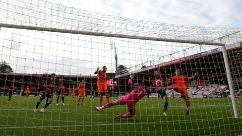 <p>               Bournemouth's Dan Gosling, second right, scores his side's opening goal during the English Premier League soccer match between Bournemouth and Newcastle at Vitality Stadium in Bournemouth, England, Wednesday, July 1, 2020. (Peter Cziborra/Pool via AP)             </p>