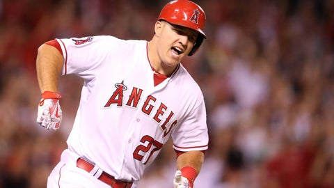 ANAHEIM, CA - JULY 17:  Mike Trout #27 of  the Los Angeles Angels of Anaheim reacts as he runs to first as his walk off home run clears the wall in the ninth inning against the Boston Red Sox at Angel Stadium of Anaheim on July 17, 2015 in Anaheim, California.  The Angels won 1-0.  (Photo by Stephen Dunn/Getty Images)