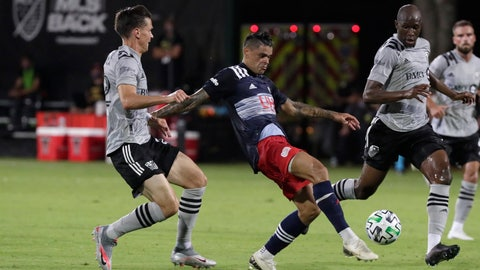 <p>               New England Revolution forward Gustavo Bou, center, attempts a shot against Montreal Impact defender Jukka Raitala, left, and defender Rod Fanni, right, during the first half of an MLS soccer match, Thursday, July 9, 2020, in Kissimmee, Fla. (AP Photo/John Raoux)             </p>