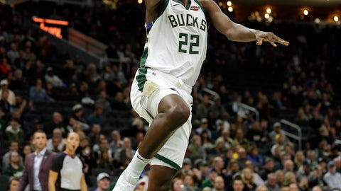 <p>               FILE - In this Oct. 17, 2019, file photo, Milwaukee Bucks' Khris Middleton (22) shoots after driving past Minnesota Timberwolves' Jake Layman during the first half of a preseason NBA basketball game in Milwaukee. The Milwaukee Bucks and Los Angeles Lakers already have just about guaranteed themselves the top two playoff seeds and face a delicate balancing act when the NBA returns to action. They must try to shake off the rust after a 4 ½-month hiatus while also staying as healthy as possible for the postseason.(AP Photo/Aaron Gash, File)             </p>
