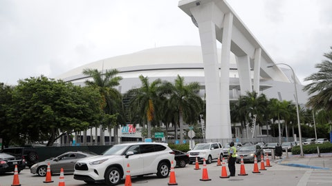 <p>               Vehicles wait in line outside of Marlins Park at a COVID-19 testing site during the coronavirus pandemic, Monday, July 6, 2020, in Miami. The long line of cars each morning as players arrive at work provides a reminder of the risks when they leave. Behavior away from the ballpark will be a big factor in determining whether Major League Baseball's attempt to salvage the 2020 season can succeed. (AP Photo/Lynne Sladky)             </p>