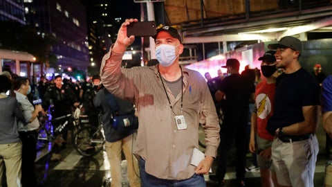 <p>               Associated Press NBA reporter Brian Mahoney records video while covering a protest, Wednesday, June 3, 2020, in New York. When the NBA season was suspended and he was reassigned to the news department,heI assumed it was just to report from here. But, according to Mahoney, there were so many coronavirus stories to tell: Health care workers trying to keep patients alive. Residents of a community who all knew somebody who had died.   (AP Photo/Seth Wenig)             </p>