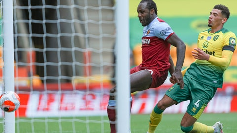 <p>               West Ham's Michail Antonio, left, scores his side's third goal, next to Norwich City's Ben Godfrey during the English Premier League soccer match between Norwich City and West Ham at the Carrow Road stadium in Norwich, England, Saturday, July 11, 2020. (AP Photo/Ian Walton, Pool)             </p>