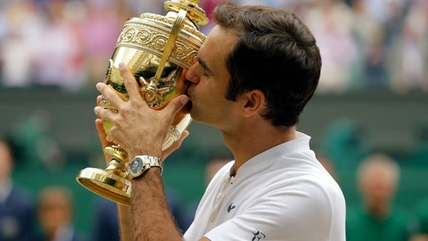 <p>               FILE - In this July 6, 2017, file photo, Switzerland's Roger Federer kisses the trophy after defeating Croatia's Marin Cilic to win the men's singles final match on day thirteen at the Wimbledon Tennis Championships in London. (AP Photo/Alastair Grant, File)             </p>